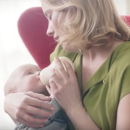 Scene from the MAM video - mother feeds baby