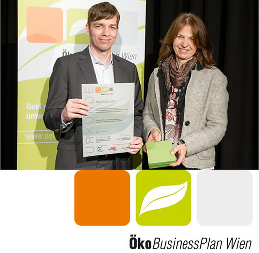 MAM employee with certificate from the Eco Business Plan Vienna