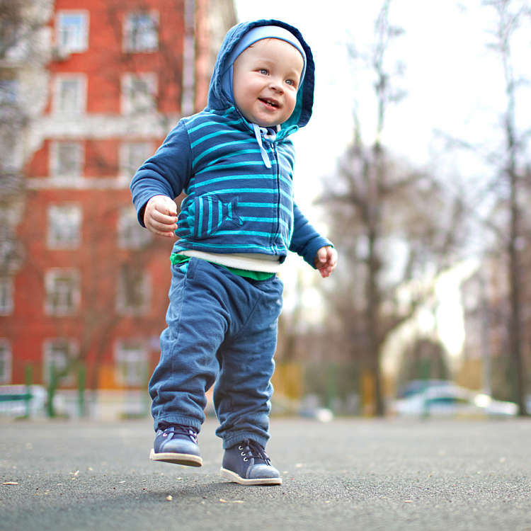 Baby boy goes for a walk outdoors