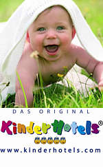Happy baby crawls on the grass www.kinderhotels.com