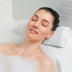 Woman lying in bathtub relaxing spa