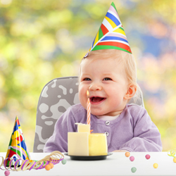 Happy baby celebrating first birthday