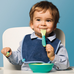 Baby boy with MAM Learn to Eat cutlery in Green